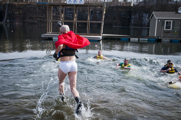 Dressed as Captain Underpants and participating in his first polar plunge, Doug Goodale of Middletown springs into the 35-degree water of Brownstone Park's quarry during the fourth annual Spring Plunge and Cannonball Competition at Brownstone Park. The fundraiser for Connecticut Children's Medical Center raised about $5,000 through about 50 participants.