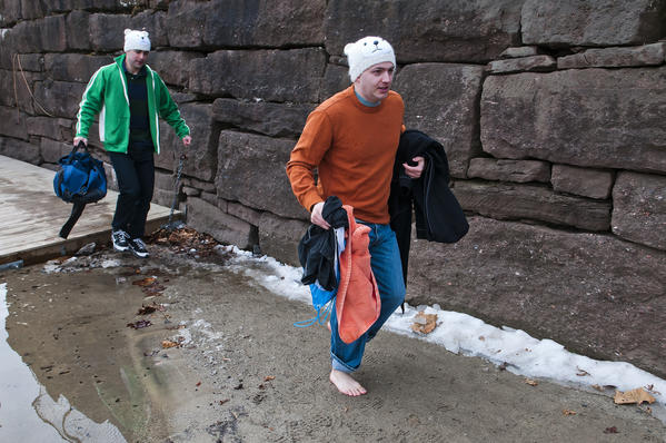 Ryan Sitarz of Rocky Hill, left, and Rob Lowry of Glastonbury, right, walk past a line of ice after plunging into the 35-degree water of Brownstone Park during the fourth annual Spring Plunge and Cannonball Competition. The fundraiser for Connecticut Children's Medical Center raised about $5,000 through about 50 participants.