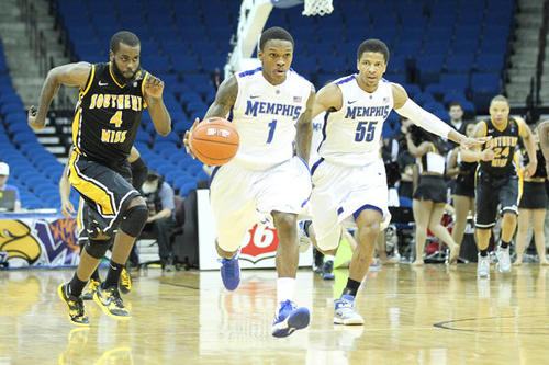 Memphis Tigers guard Joe Jackson (1) leads a fast break after a steal as Southern Miss Golden Eagles forward Dwayne Davis (4) and Tigers guard Geron Johnson (55) look on during the championship game of the Conference USA tournament at the BOK Center. Memphis defeated Tulsa 91-79.