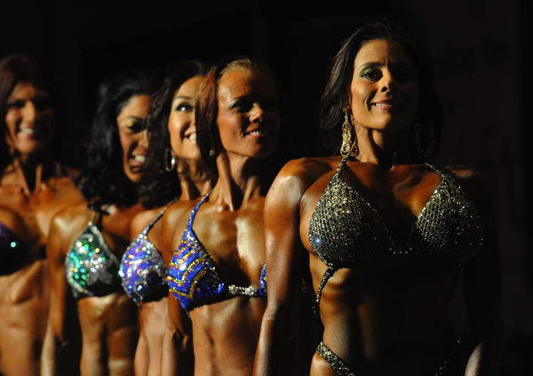 Women competing in the fitness figure competition pose  for the judges Saturday at the Sunshine Classic Bodybuilding and Physique Contest at the Palm Beach County Convention Center. The event included at the 2013 6th Annual NPC CJ Classic Fitness, Figure and Bikini Championships, the 19th Annual NPC National Wheelchair Bodybuilding Championships and the 30th annual NPC Sunshine Classic Bodybuilding Championships.