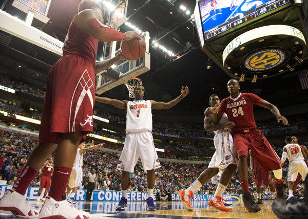 Alabama Crimson Tide guard Trevor Lacey (5) looks to pass the ball to Alabama forward Devonta Pollard (24) in front of Florida Gators guard Kenny Boynton (1) during the semifinals of the SEC tournament at Bridgestone Arena. Florida won 61-51.