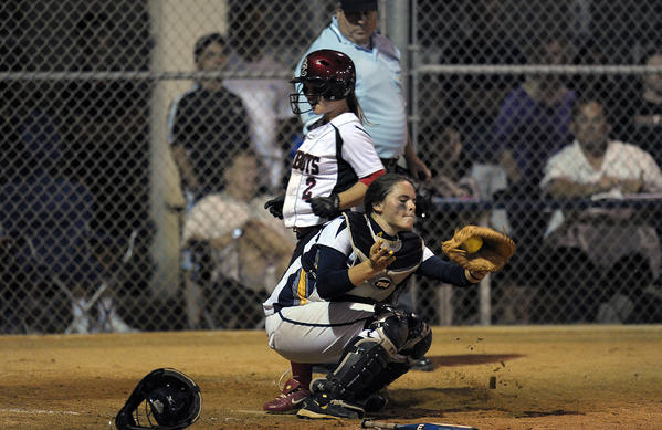 St. Thomas Aquinas' Gwen Svekis is among the solid group of catchers proving softball is about more than pitching dominance.