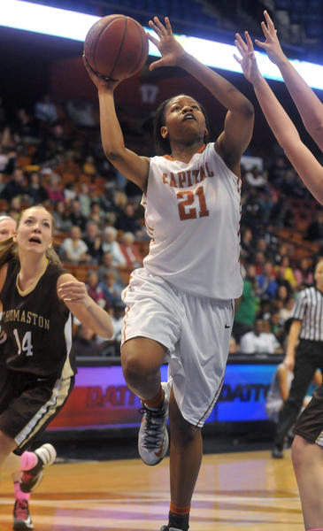 Capital Prep's Desiree Elmore in action against Thomaston in the Class S girls state basketball championship at Mohegan Sun Arena Saturday.