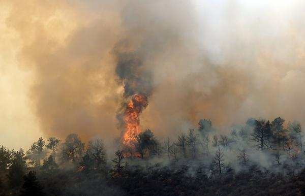 A wildfire burns out of control at Horsetooth Reservoir west of Fort Collins, Colo.
