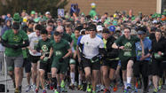 "<span style=""font-size: medium;"">Dedicated runners, many of them in costumes, began their Irish holiday by running in the 4th Annual St. Patrick's 5K.</span>"