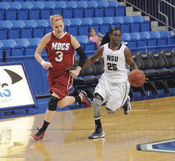 Nova Southeastern University sophomore Danielle Robinson, a South Broward High grad, right, dribbles the ball upcourt against Florida Southern's Kirstin McIntyre.