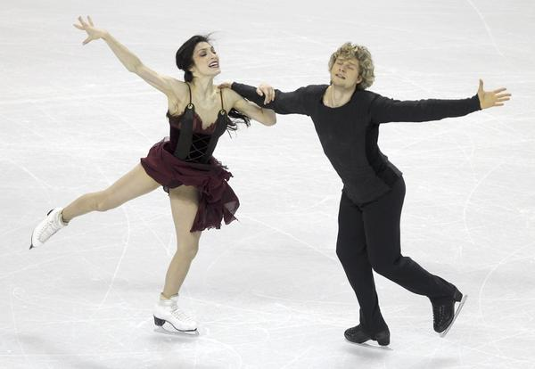Meryl Davis and Charlie White perform their ice dance free dance at the ISU World Figure Skating Championships in London, Ontario.