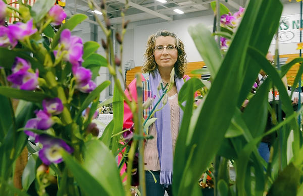 Wendy Hoover of Hagerstown looks over plants at the HCC Alumni Association Flower & Garden Show held Saturday.