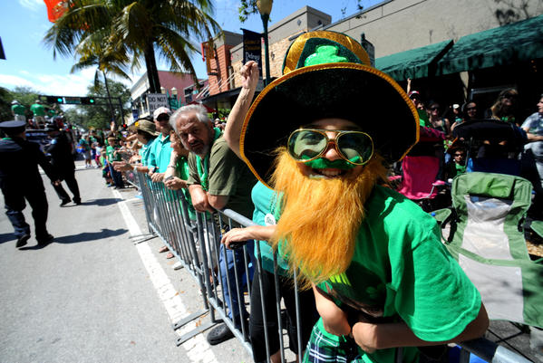 Andrew LaRocca of Boynton Beach enjoys Delray Beach's 45th Annual St. Patrick's Day Parade & Party along Atlantic Avenue. Over 75,000 people attended the event that featured local fire departments as well as those from around the world. 3/16/13. Jim Rassol, Sun Sentinel...