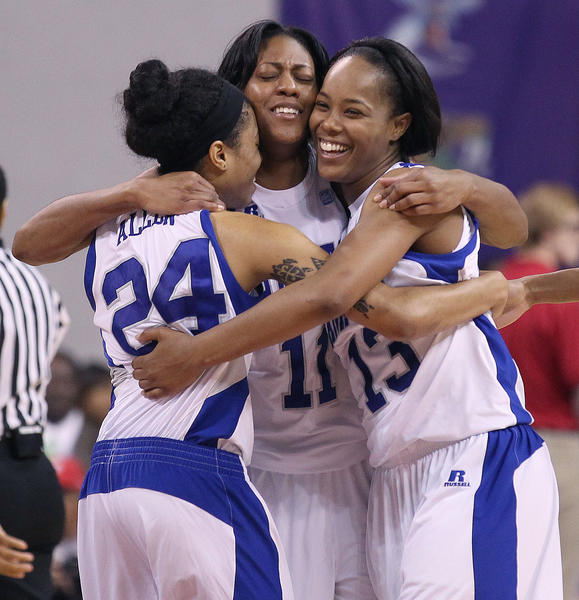 Olivia Allen, Ariel Phelps and Keiara Avant of Hampton University celebrate as the final seconds tick away on their 59-38 MEAC championship victory over Howard Saturday in Norfolk.