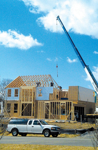 Workers on Thursday put roof tresses on a home being built for Dan Ryan Builders in the Spring Run Estates neighborhood in Washington Township, Pa., near Waynesboro, Pa.