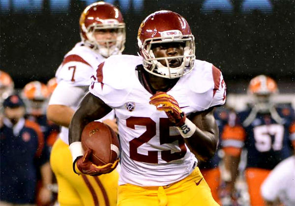 USC running back Silas Redd gets a hand off from Matt Barkley during a game against Syracuse.