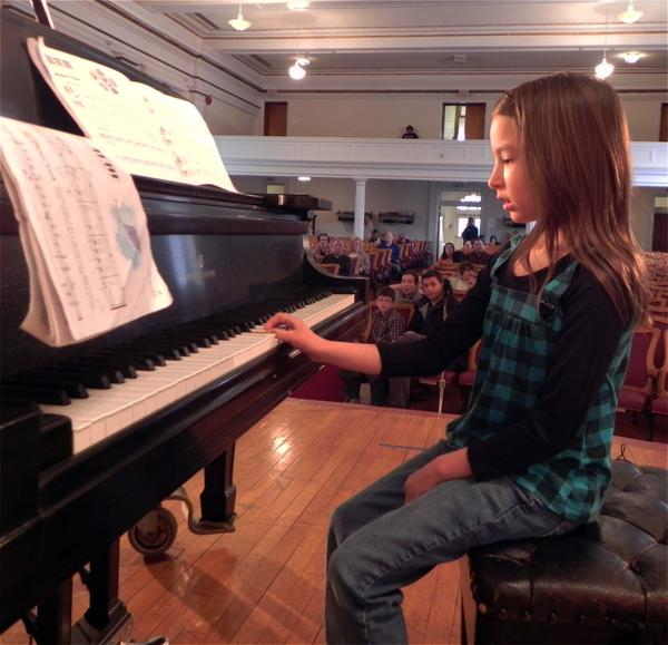 """Madison Hartman, 7, Shippensburg, Pa., plays """"Mulberry Bush"""" on the piano for Saturday's Performathon to benefit the Cumberland Valley School of Music at Wilson College in Chambersburg, Pa."""