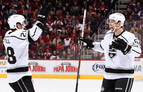 Jake Muzzin, right, celebrates with Jarret Stoll after scoring a third-period goal during the Kings¿ 4-2 victory over the Phoenix Coyotes at Jobing.com Arena earlier this season.