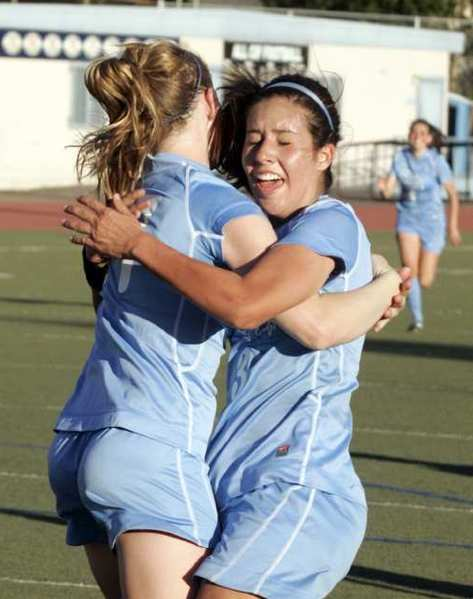 Crescenta Valley's Jacque Phinney, right, hugs to congratulate Sierra Rhoads who just scored a goal late in the second half against Arcadia in a Pacific League girls soccer match at Crescenta Valley High School in La Crescenta on Thursday, February 9, 2012. For four seasons, the Crescenta Valley High girls' soccer trio of Sierra Rhoads, Whitley Boller and Katie Callister plied their trade in helping and eventually leading the Falcons to Pacific League success and a pair of playoff wins.