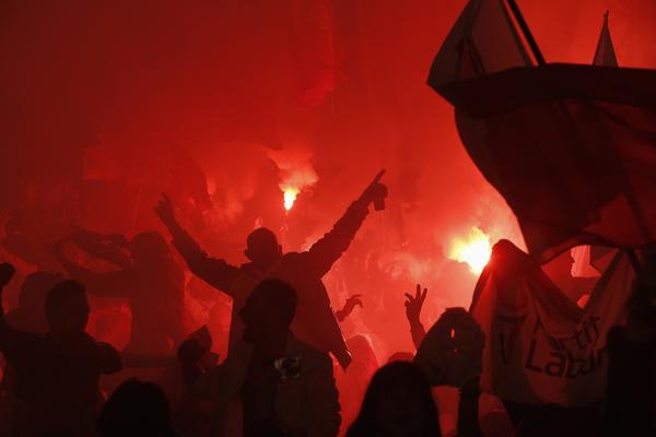 Labour Party supporters light flares as they celebrate during an election victory mass meeting in Floriana, outside Valletta, March 16, 2013. Malta's Labour Party won a national election last week, returning to power after 15 years in opposition.