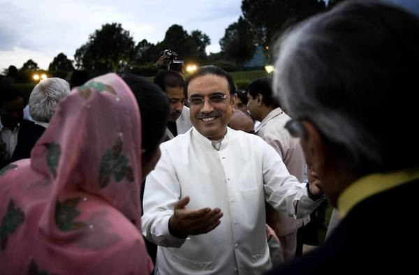 The government of Pakistani President Asif Ali Zardari, center, ended