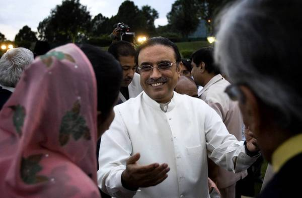 The government of Pakistani President Asif Ali Zardari, center, ended its five-year term Saturday, setting the stage for the country's first transfer of power from one civilian government to another.