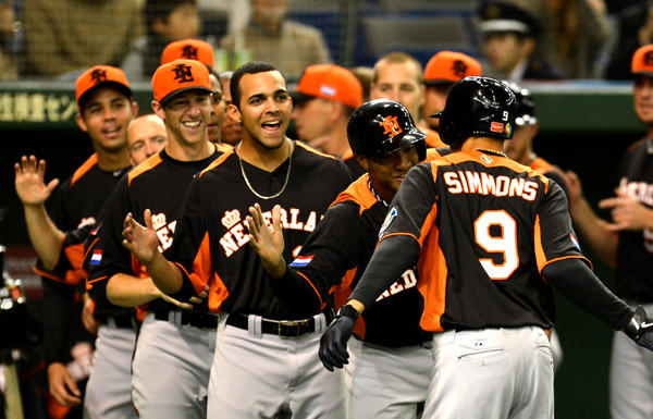 The Netherlands infielder Andrelton Simmons is congratulated by teammates after his solo homer against Japan during a pool-play game in the World Baseball Classic