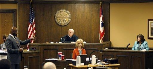 Defense attorney Walter Madison, left, cross-examines forensic scientist Laureen Marinetta, right, as Judge Thomas Lipps, center, listens on the fourth day of the rape trial against Trent Mays, 17, and Ma'lik Richmond, 16, in juvenile court in Steubenville, Ohio.