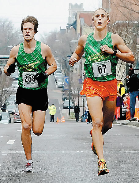 Wade Miller, left, and Tony Clement race to the finish line on South Potomac Street in Hagerstown at the St. Patrick's Day Run for Your Luck 5K on Saturday morning. Clement prevailed by a tenth of a second.