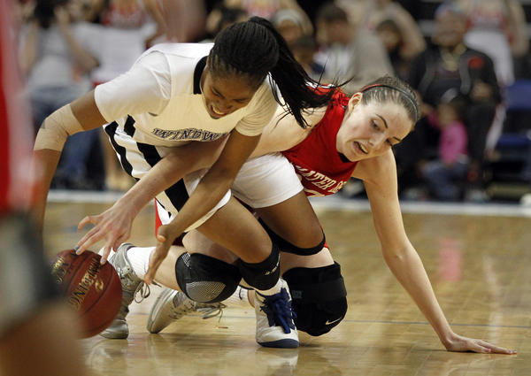 Windward point guard Jordin Canada, left, battles Mater Dei forward Katie Lou Samuelson for a loose ball in the second half of the CIF Southern California Open Division championship game at Citizens Business Bank Arena in Ontario.