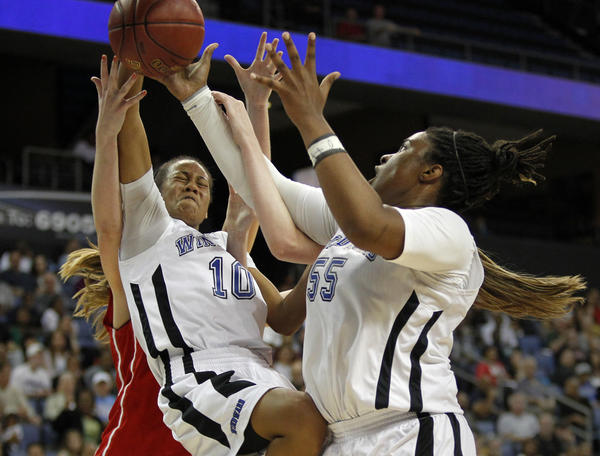 Windward guard Courtney Jaco,(10) and forward Kristen Simon (55) battle Mater Dei forward Katie Lou Samuelson, left rear, and guard Karlie Samuelson for a rebound in the second half Saturday night.