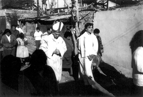 Cardinal Jorge Mario Bergoglio visits a shantytown in Buenos Aires in an undated photo.