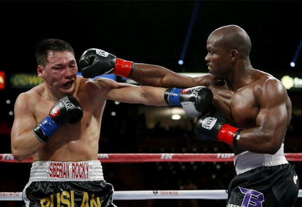 Timothy Bradley, right, punches Ruslan Provodnikov in the fourth round of their WBO welterweight title match.