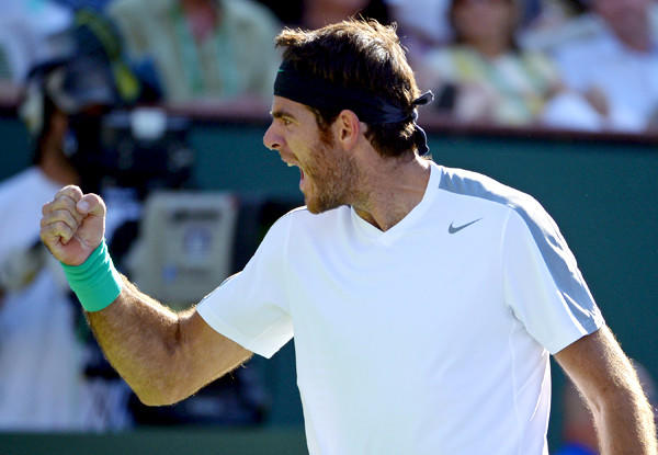 Juan Martin del Potro celebrates winning a game over Novak Djokovic in a semifinal at the BNP Paribas Open tennis tournament in Indian Wells on Saturday.