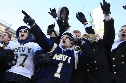 Navy fans cheer the Midshipmen during the 110th Army-Navy game.