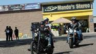 Bikers depart from Mando's Stereo