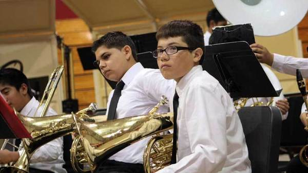 "William Moreno Jr. High School Concert Band members take their positions before their performance during the Southern California School Band and Orchestra Association¿s Band and Orchestra Festival at Imperial High School on Saturday. The band played ""Alpha Overture"" by John Edmondson, ¿By Dawn's Early L""ght"" by David Shaffer and ""Dorian Rhapsody"" by Elliot Del Borgo."