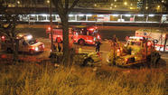 A silver car wound up entangled in a tree and had to be pulled off an embankment by a tow truck early Sunday morning on the Eisenhower Expressway, but those in the car escaped with minor injuries, police said.