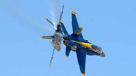 The Blue Angels solo jets perform a maneuver