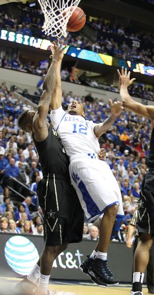 Kentucky guard Ryan Harrow (12) took the blame for UK¿s 64-48 loss to Vanderbilt in the SEC¿quarterfinals on Friday. Harrow went just 2-for-15 from the floor with four turnovers and just one assist.