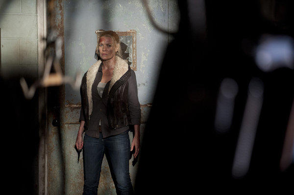 Andrea (Laurie Holden) tries to make it to the prison on foot without the Governor catching her.
