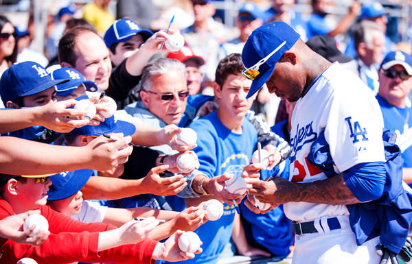 Dodgers outfielder Carl Crawford signs autographs before an exhibition game against the Chicago White Sox last month at Camelback Ranch.