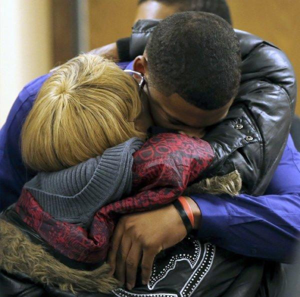 Ma'lik Richmond, top, hugs his mother, Daphne Birden, after closing arguments in the rape trial of Richmond and Trent Mays in Steubenville, Ohio.