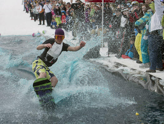 Preston Rivera, of Emmaus, heads through the water as skiers and snowboarders skim across a man made pond at Bear Creek in their pond skimming event as part of their Spring Fling Weekend. Over 50 people took part in the event.
