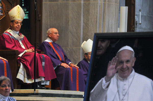 A photograph of the Pope Francis was on display during the Liturgy of Thanksgiving led by The Archbishop of Baltimore, The Most Rev. William E. Lori, seated at left, to celebrate the election of the new Pope at The Cathedral of Mary Our Queen on Sunday.