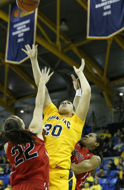 Quinnipiac Bobcats forward Brittany McQuain shoots over St. Francis Red Flash sophomore Alexa Hayward in the first half of the championship game of the NEC tournament at the TD Banknorth Center in Hamden.