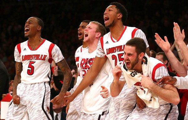 Louisville players celebrate as the Cardinals close out a victory over Syracuse in the Big East Conference tournament final on Saturday.