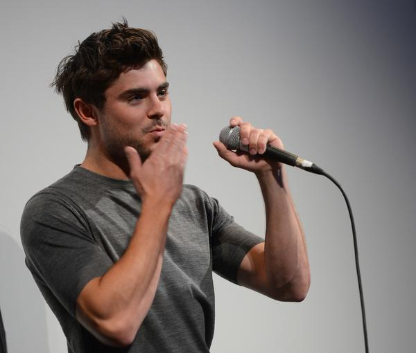 "Zac Efron speaks at the screening for ""At Any Price."""
