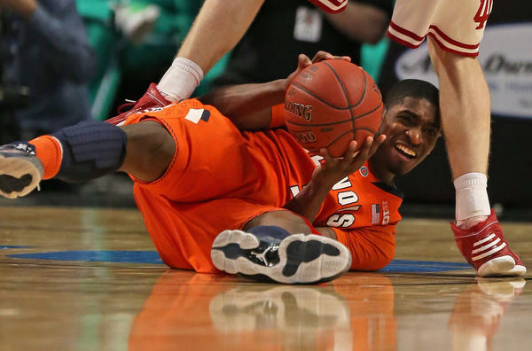 CHICAGO, IL - MARCH 15: Brandon Paul #3 of the Illinois Fighting Illini grabs the ball from the floor against the of the Indiana Hoosiers during a quarterfinal game of the Big Ten Basketball Tournament at the United Center on March 15, 2013 in Chicago, Illinois. (Photo by Jonathan Daniel/Getty Images) ORG XMIT: 159459467