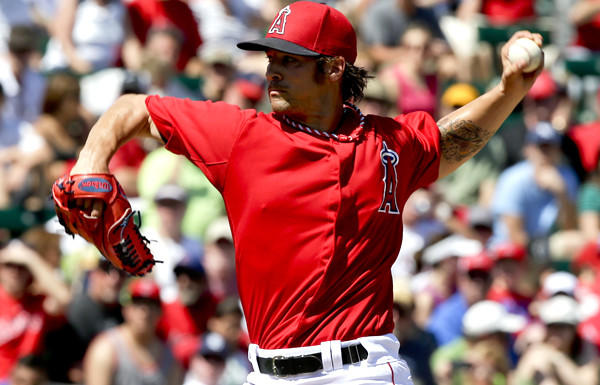 Angels starting pitcher C.J. Wilson delivers a pitch in the first inning against the Padres on Sunday.