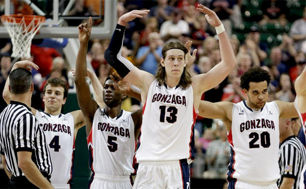 Gonzaga players celebrate as they come off the court near the end of their victory over Saint Mary's during the West Coast Conference tournament championship.