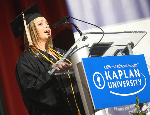 Brittany Barber speaks during Kaplan University commencement services Sunday afternoon at North Hagerstown High School.