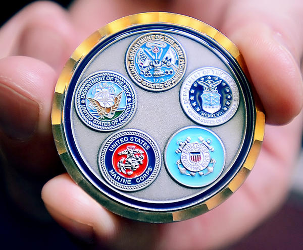 This coin, displayed by Kaplan University Hagerstown Campus President Chris Motz, was given Sunday to Kaplan University graduates who served in the U.S. Armed Forces.