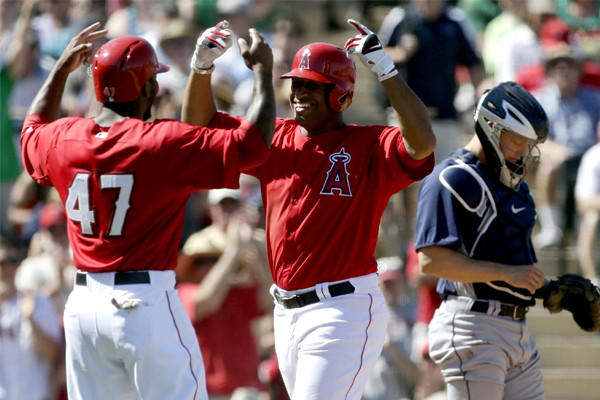 Angels' Vernon Wells, center, celebrates his two-run home run with Howie Kendrick.